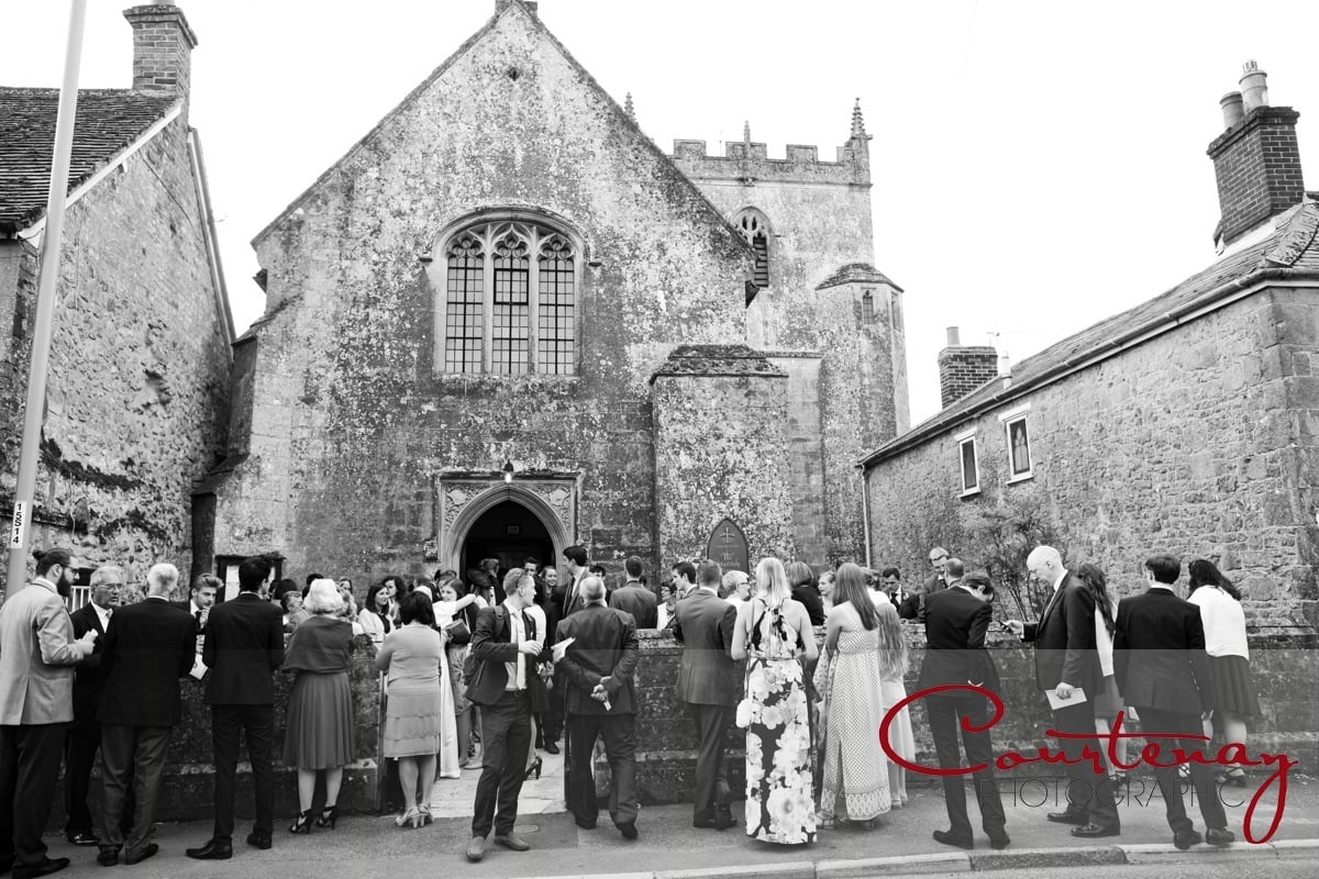 wedding guests and family congregate outside church