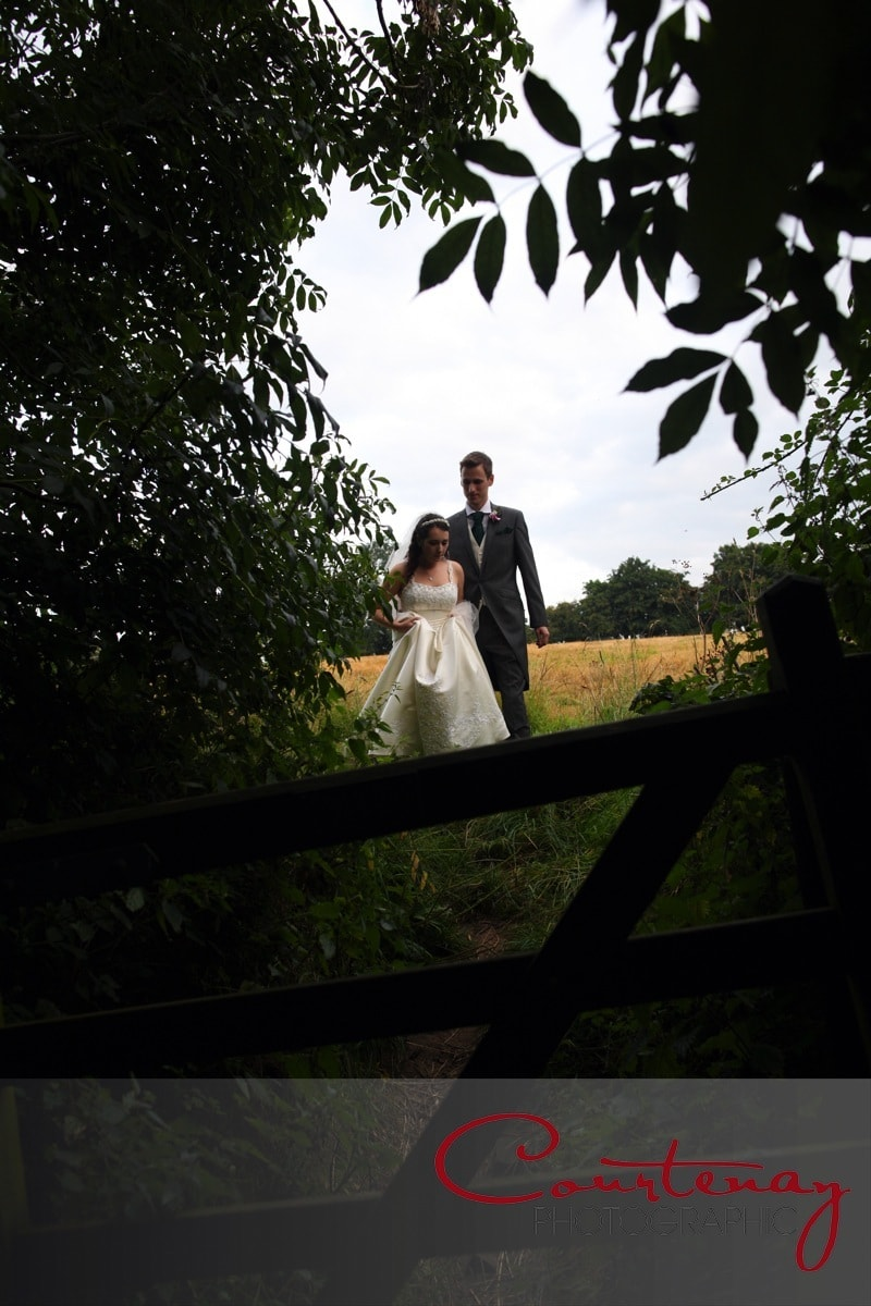 happy couple through the field gate