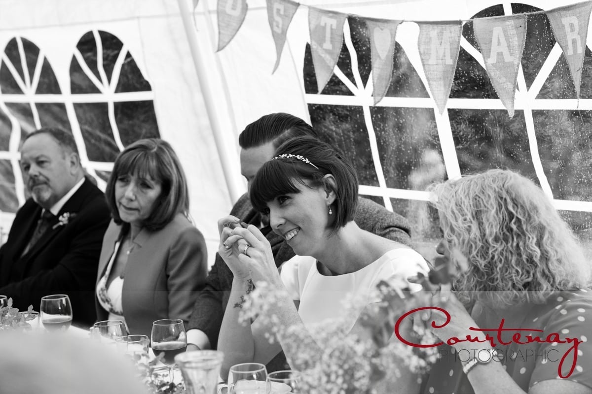 bride enjoying wedding speeches