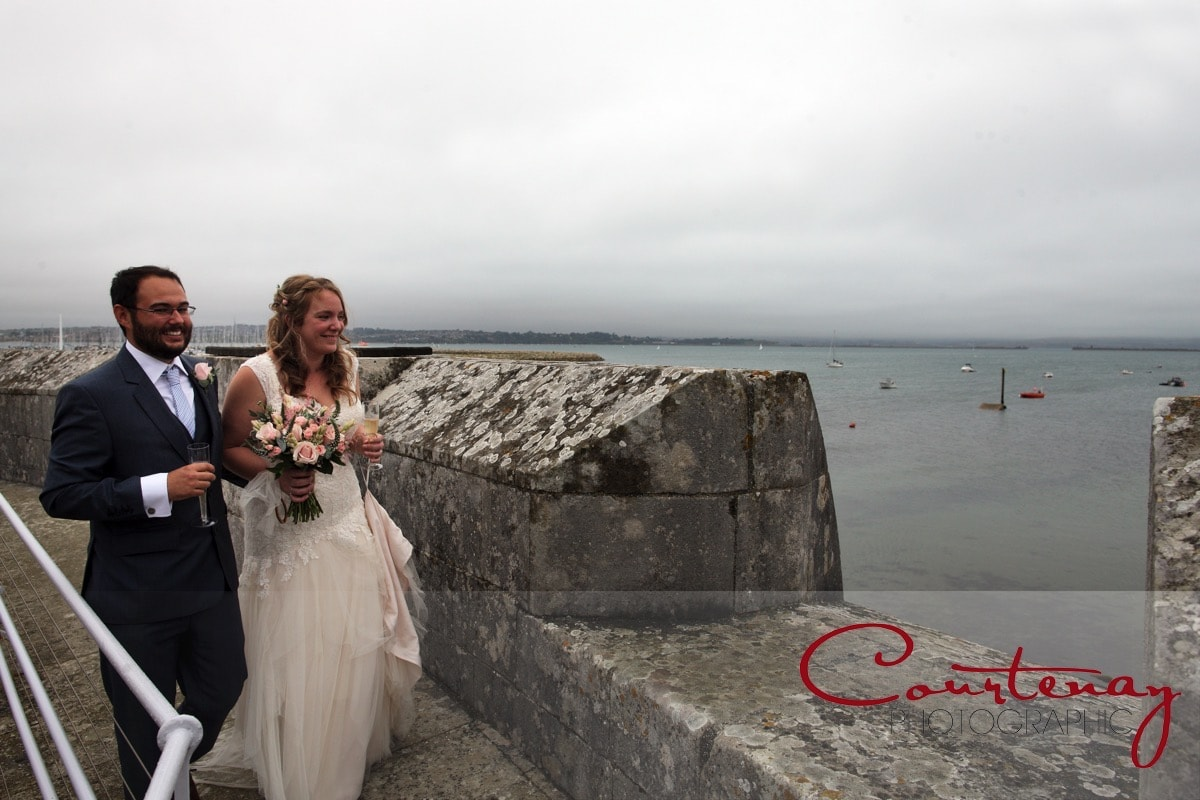 bride and groom take in the sea air