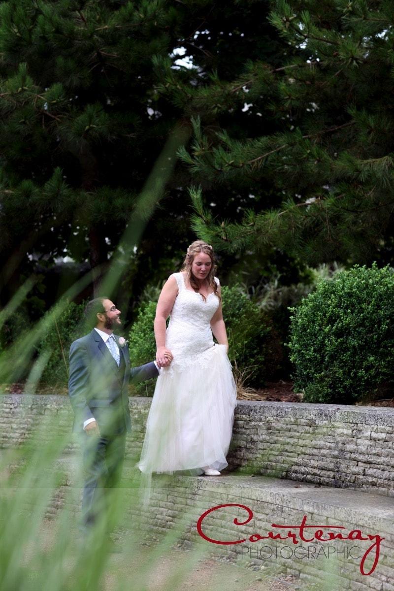 bride and groom take a romantic stroll