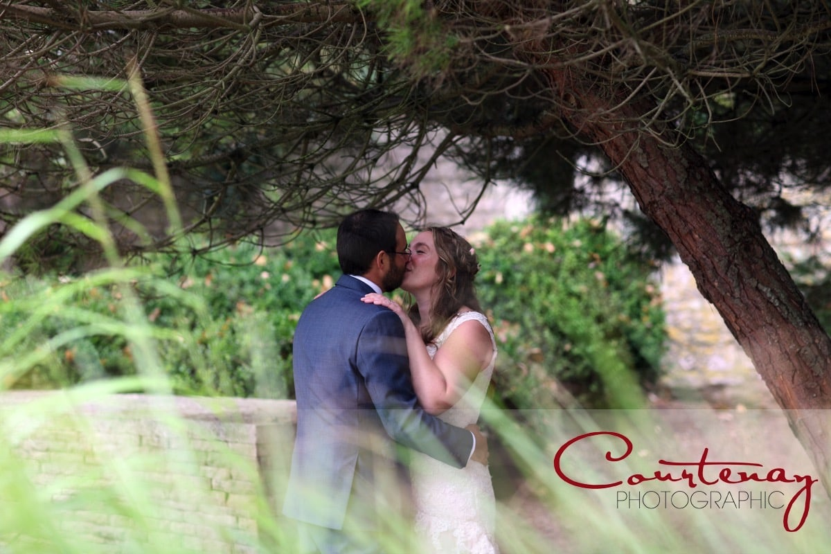bride and groom enjoy romantic kiss