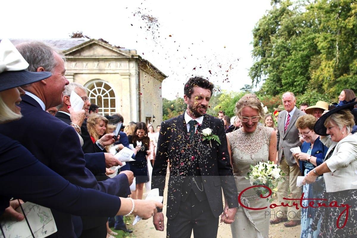 bride and groom run the confetti gauntlet