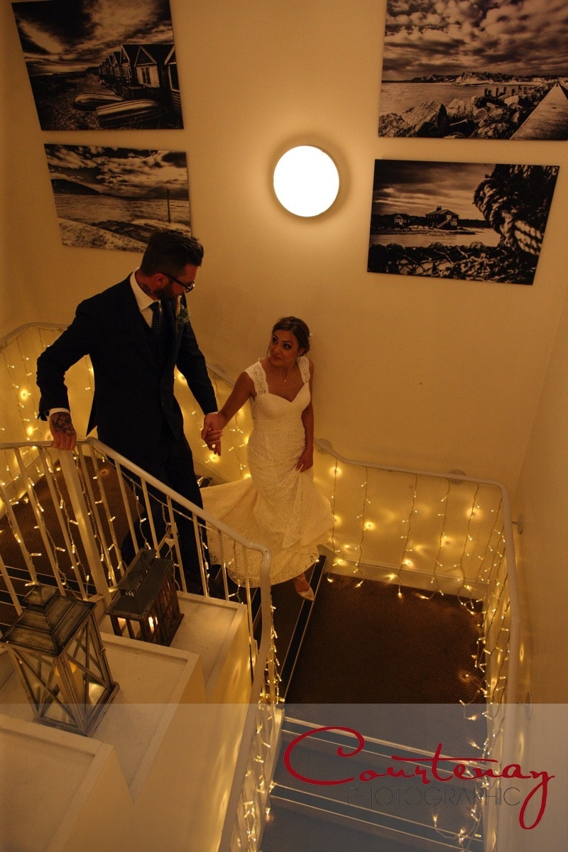 bride and groom head downstairs
