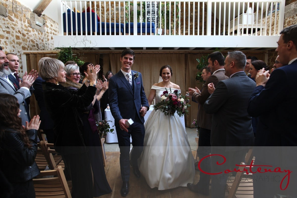 bride and groom exit tithe barn