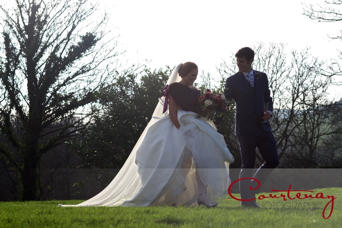 bride and groom take a gentle stroll