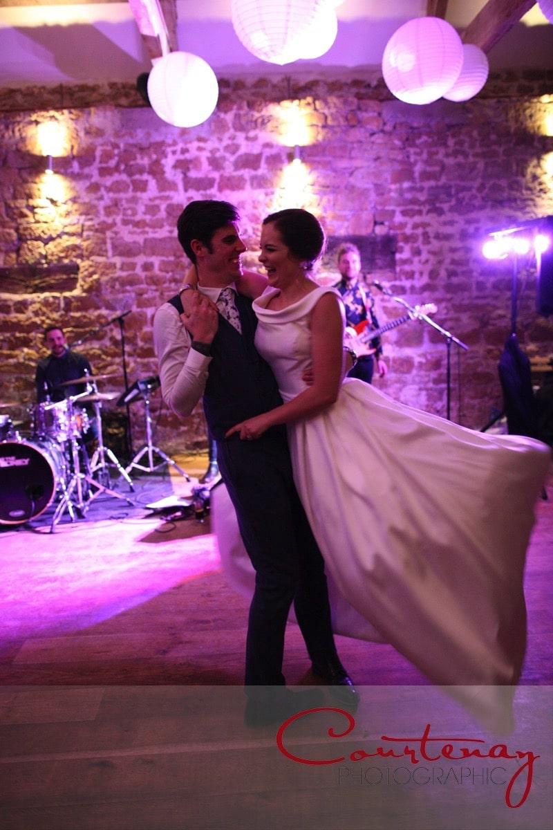groom swings bride round off the dance floor