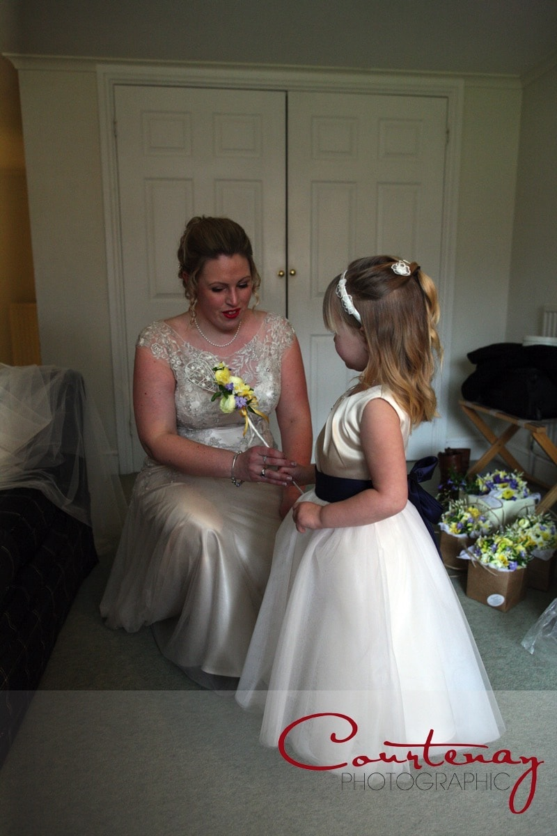 bride gives flowergirl her wand