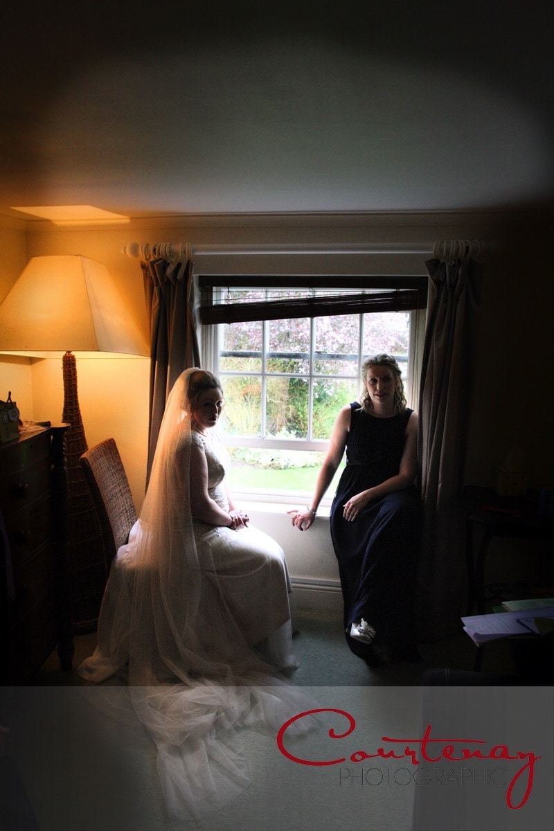 bride and bridesmaid wait ready to go
