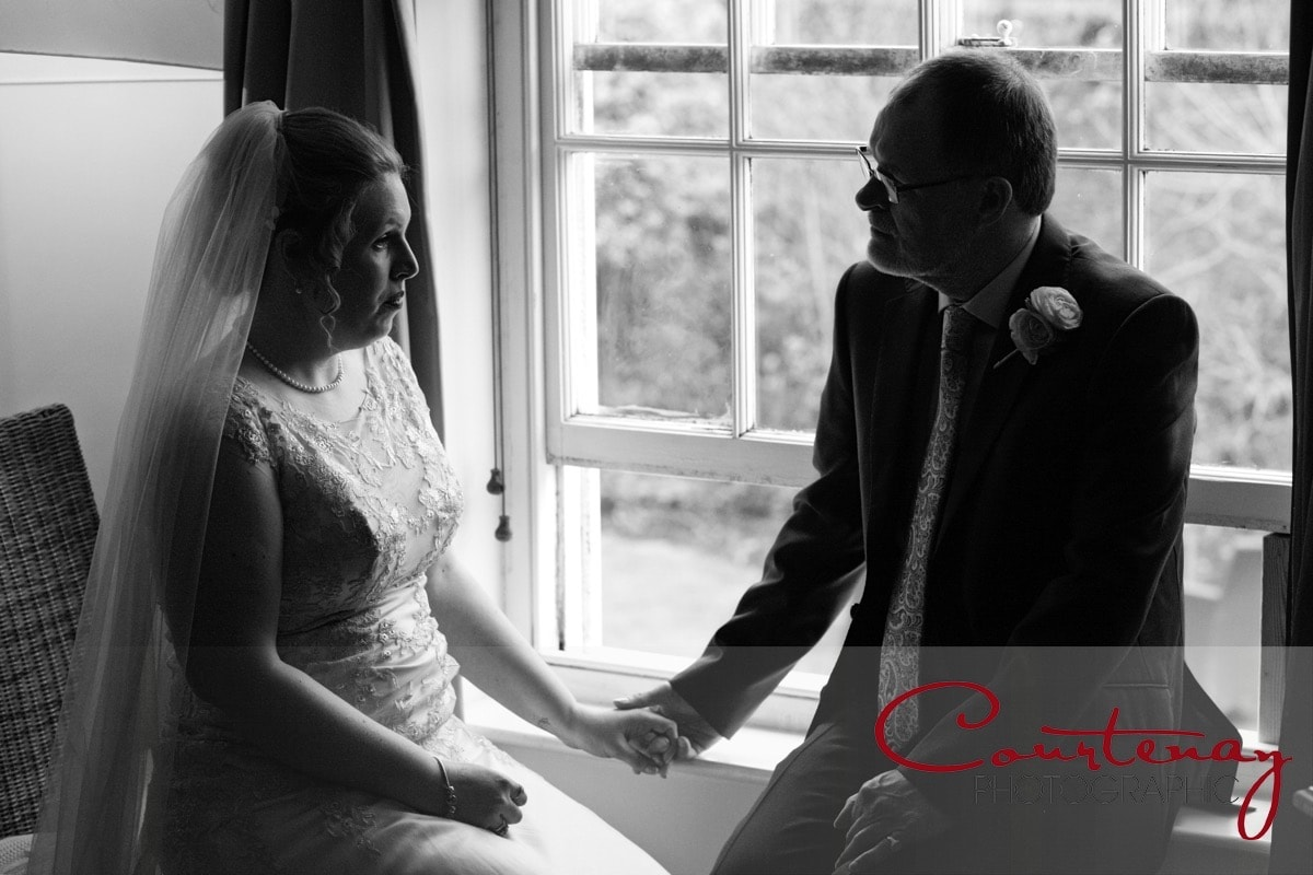 bride and dad share a moment