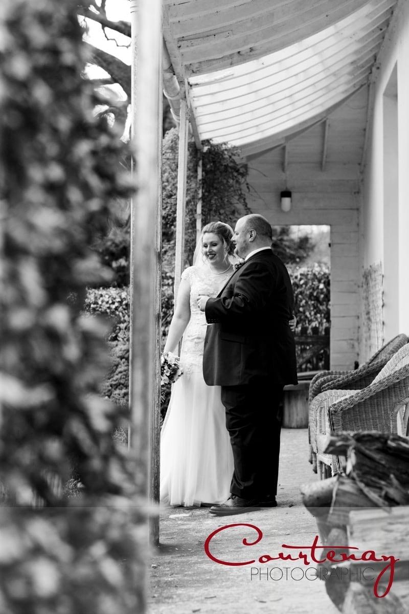 happy couple stand on the veranda
