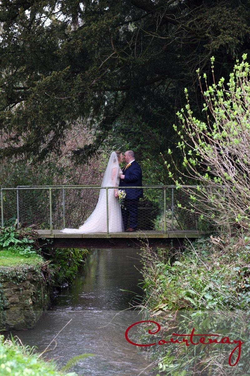 happy couple enjoy a kiss on a bridge