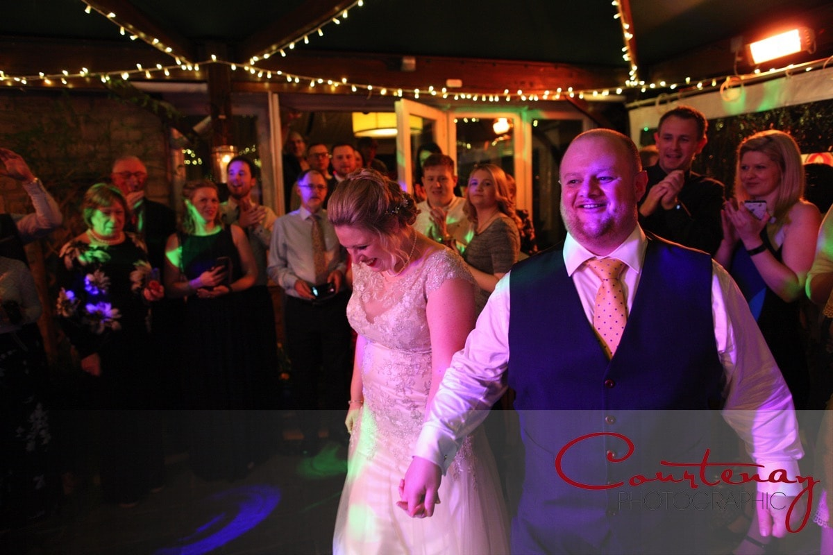 happy couple walk onto the dance floor