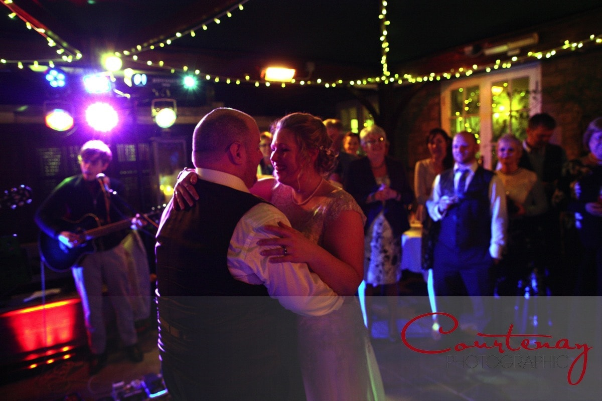 happy couple enjoy their first dance