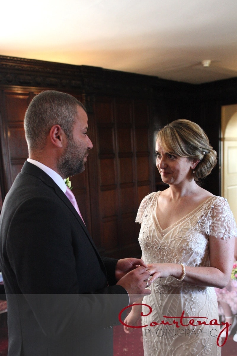 vows in the Oak room at Mortons House Wedding