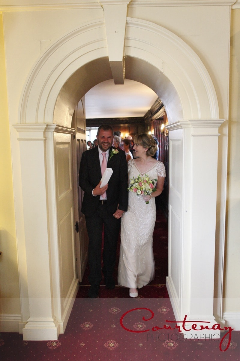 bride and groom leave the ceremony room