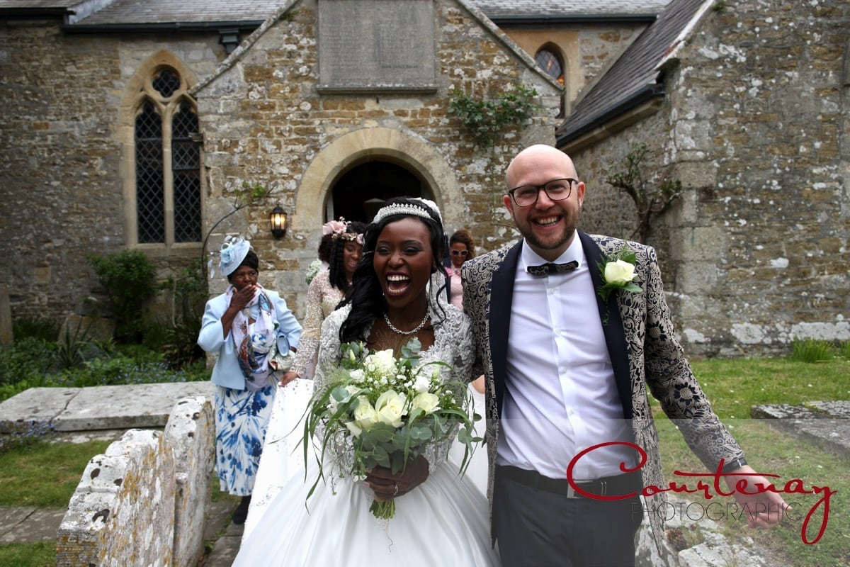 newlyweds leave the churchyard