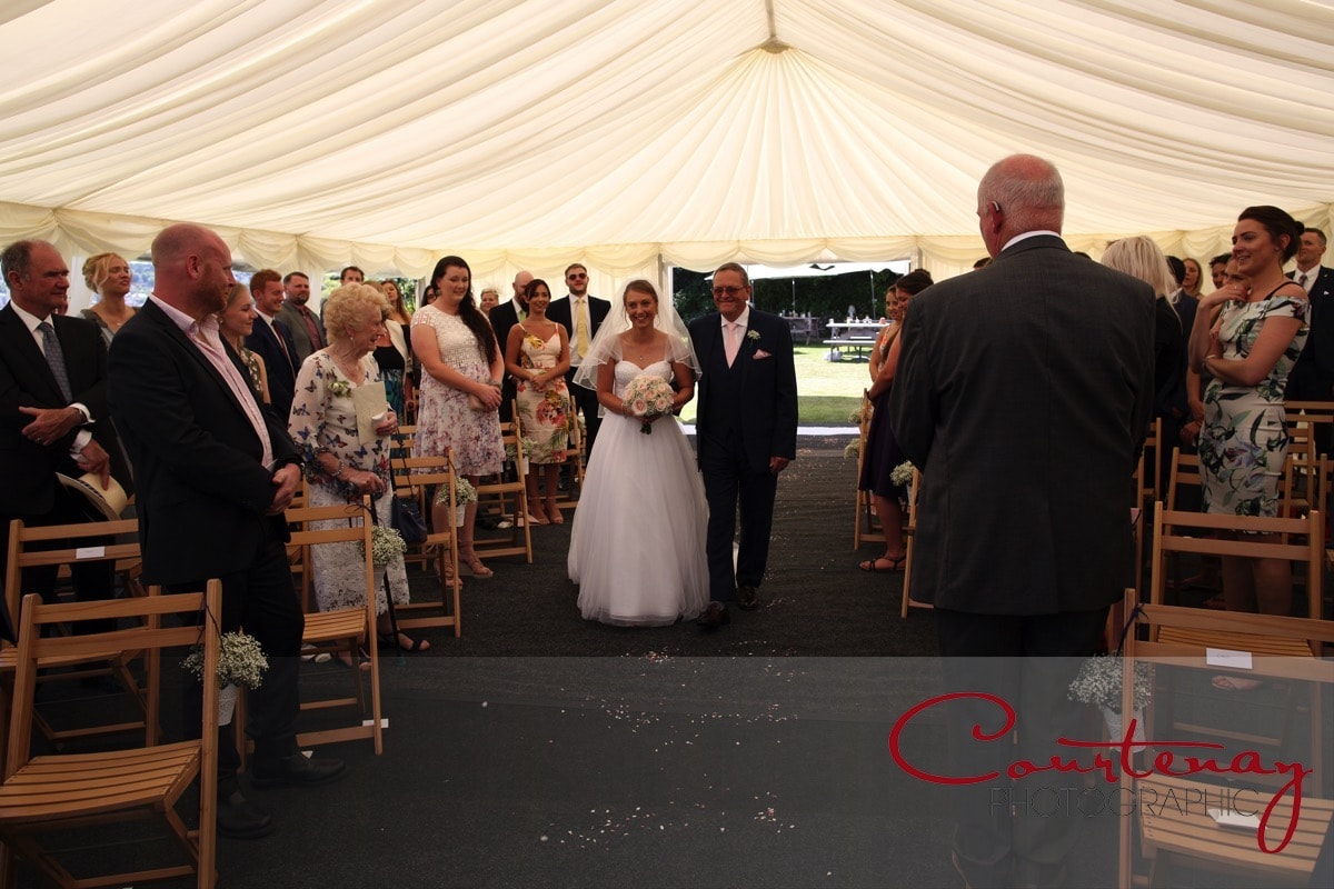 bride walks down the aisle of marquee at Grand Hotel Wedding