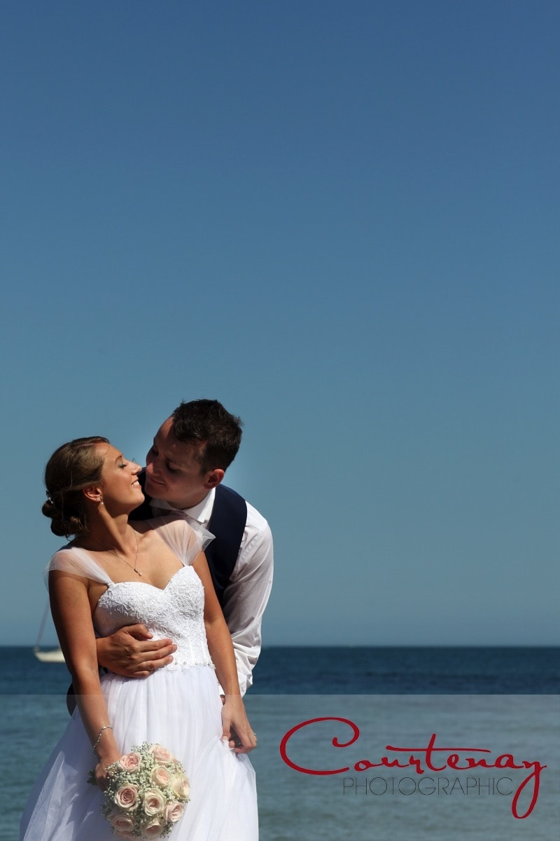 newlyweds enjoy a private moment