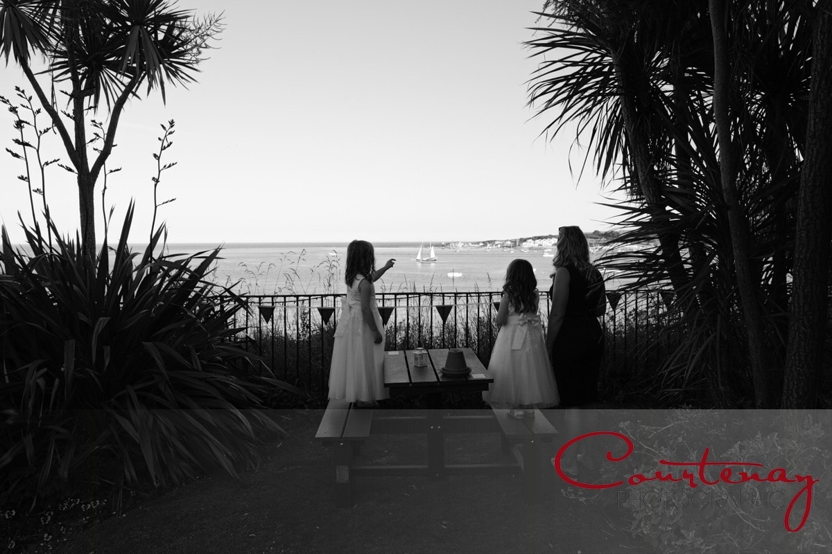 flower girls enjoy the seaside view