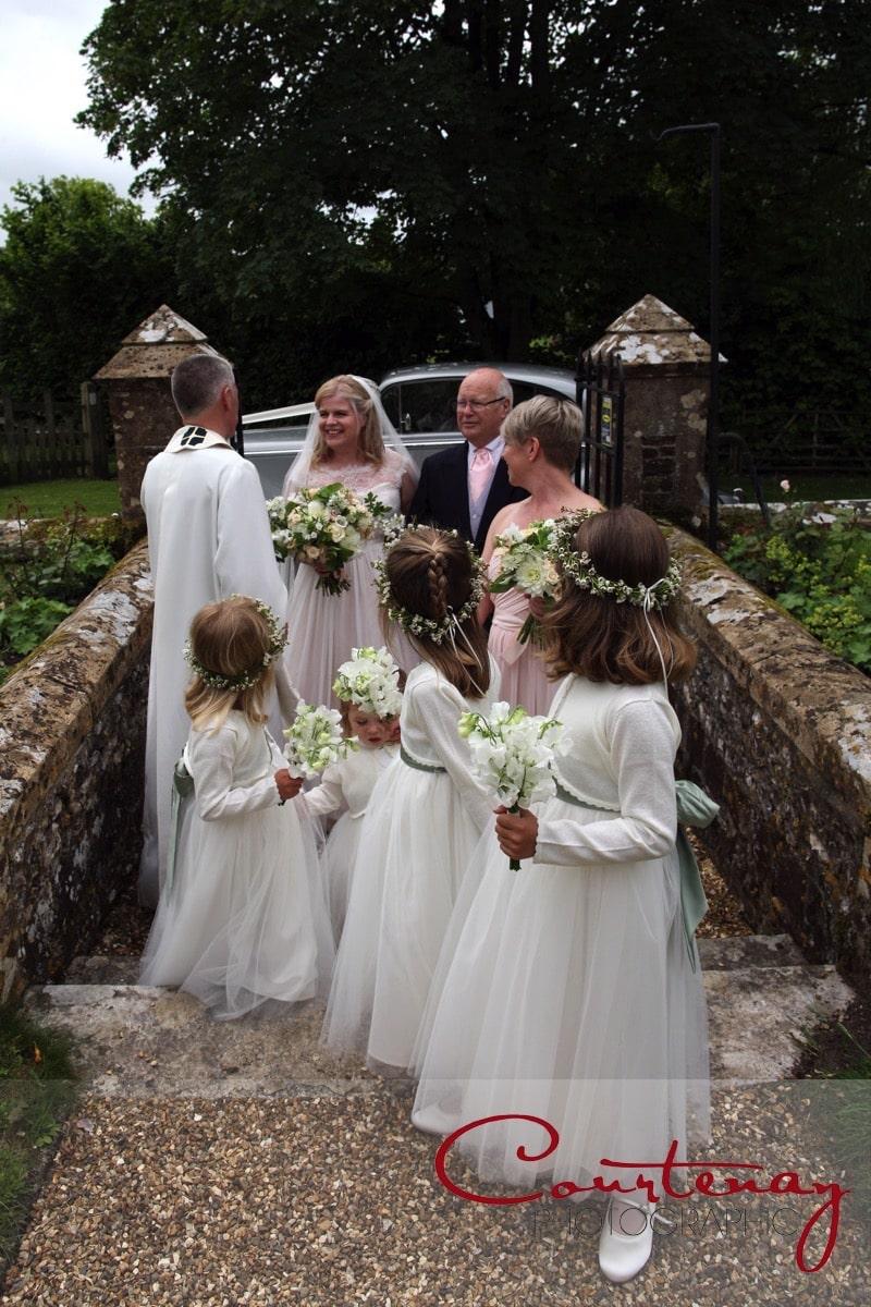 vicar greets the bride