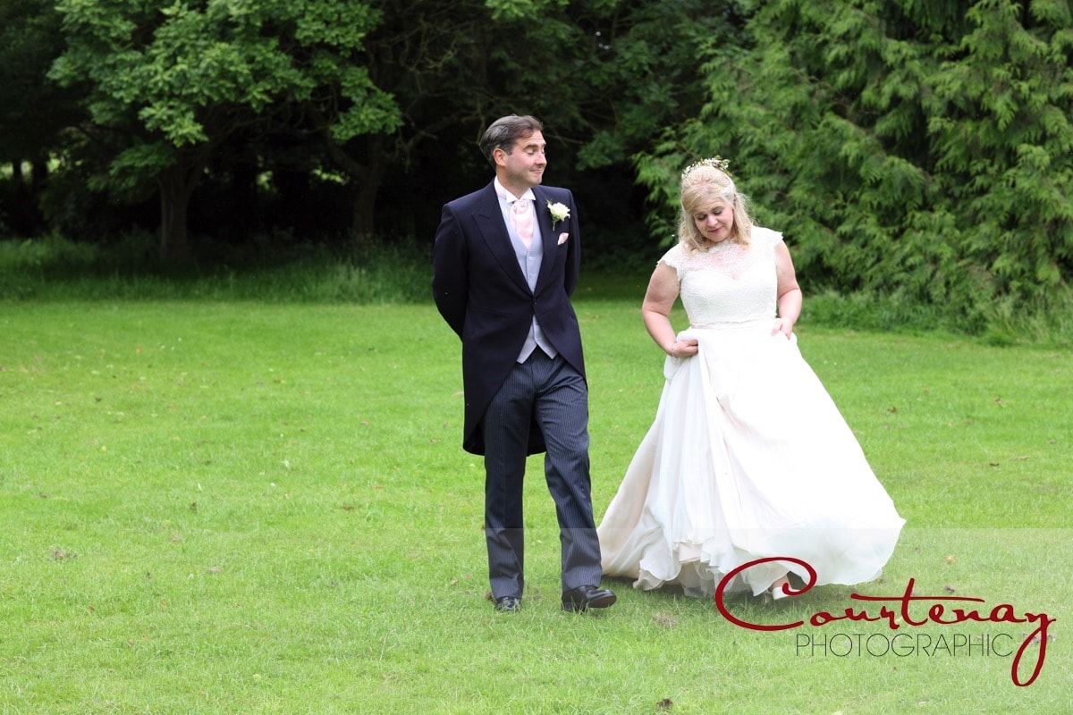 bride and groom enjoy a gentle stroll