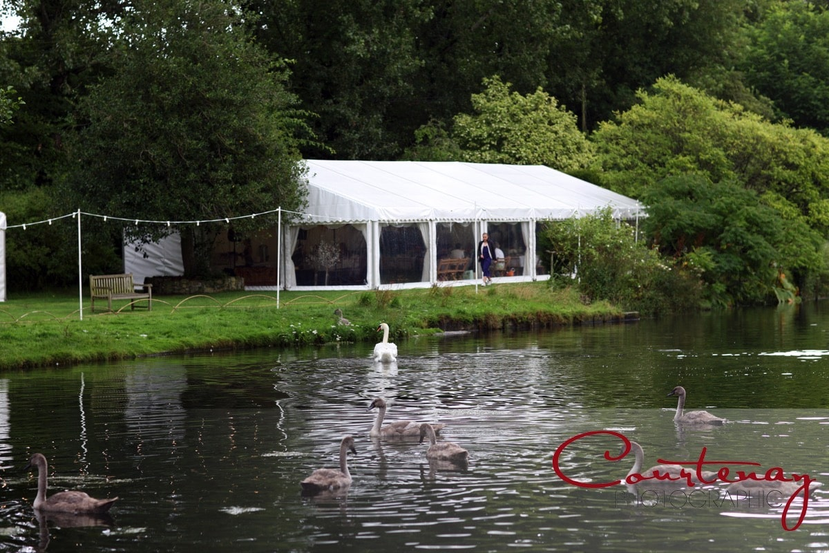 marquee accross the lake at Springhead Trust Wedding