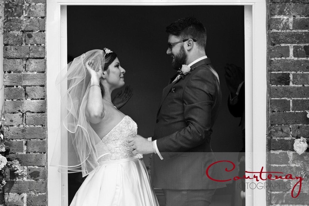 groom lifts veil