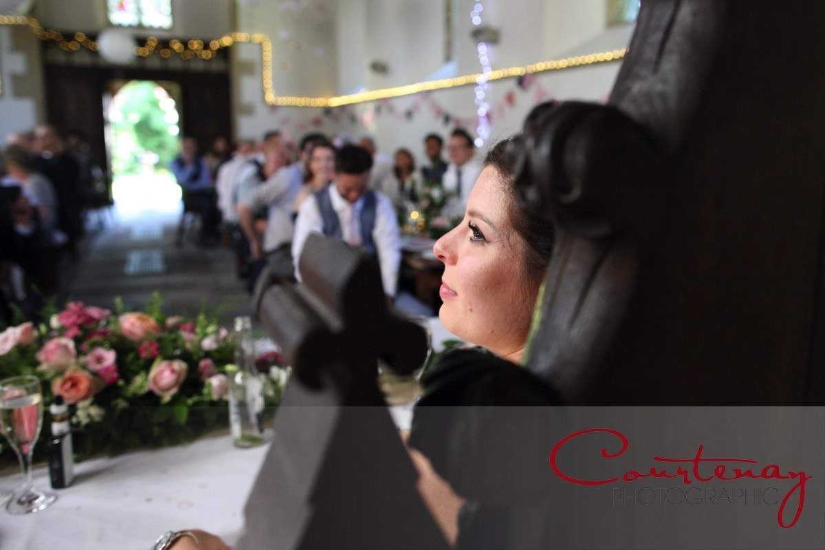 bride enjoying the speeches