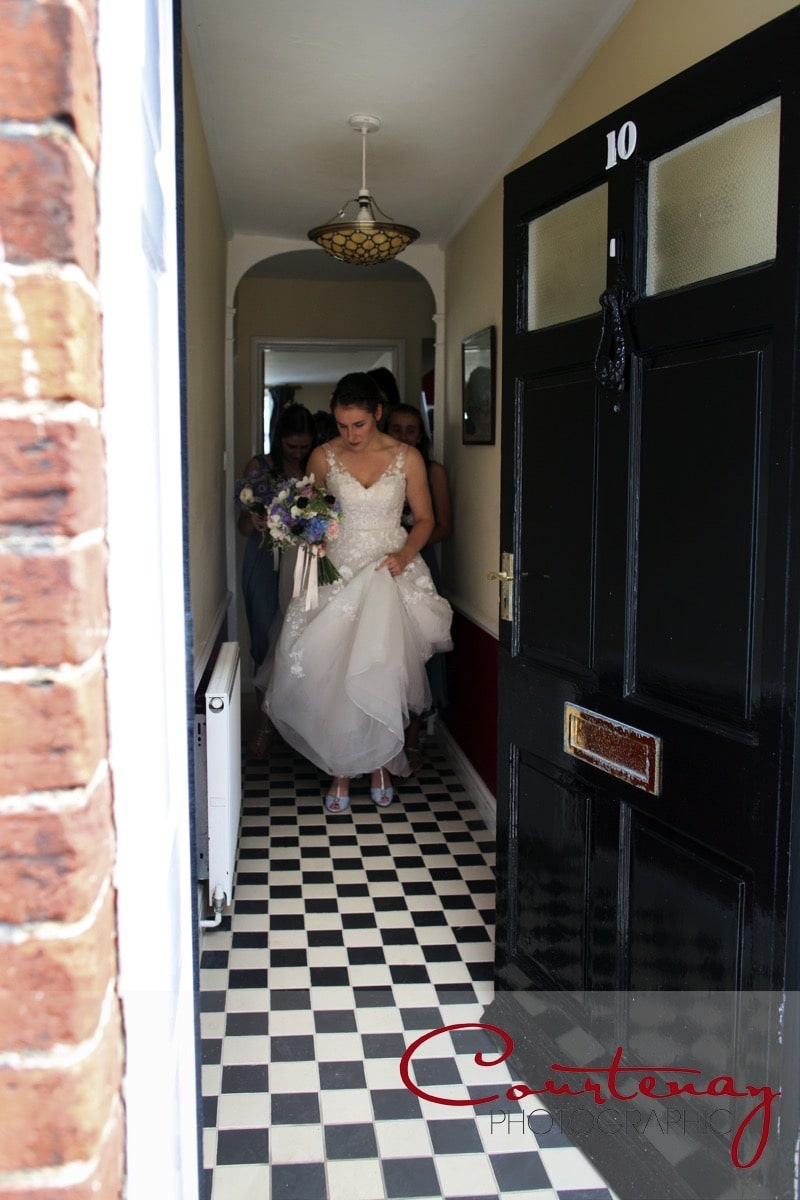 bride heads out the door