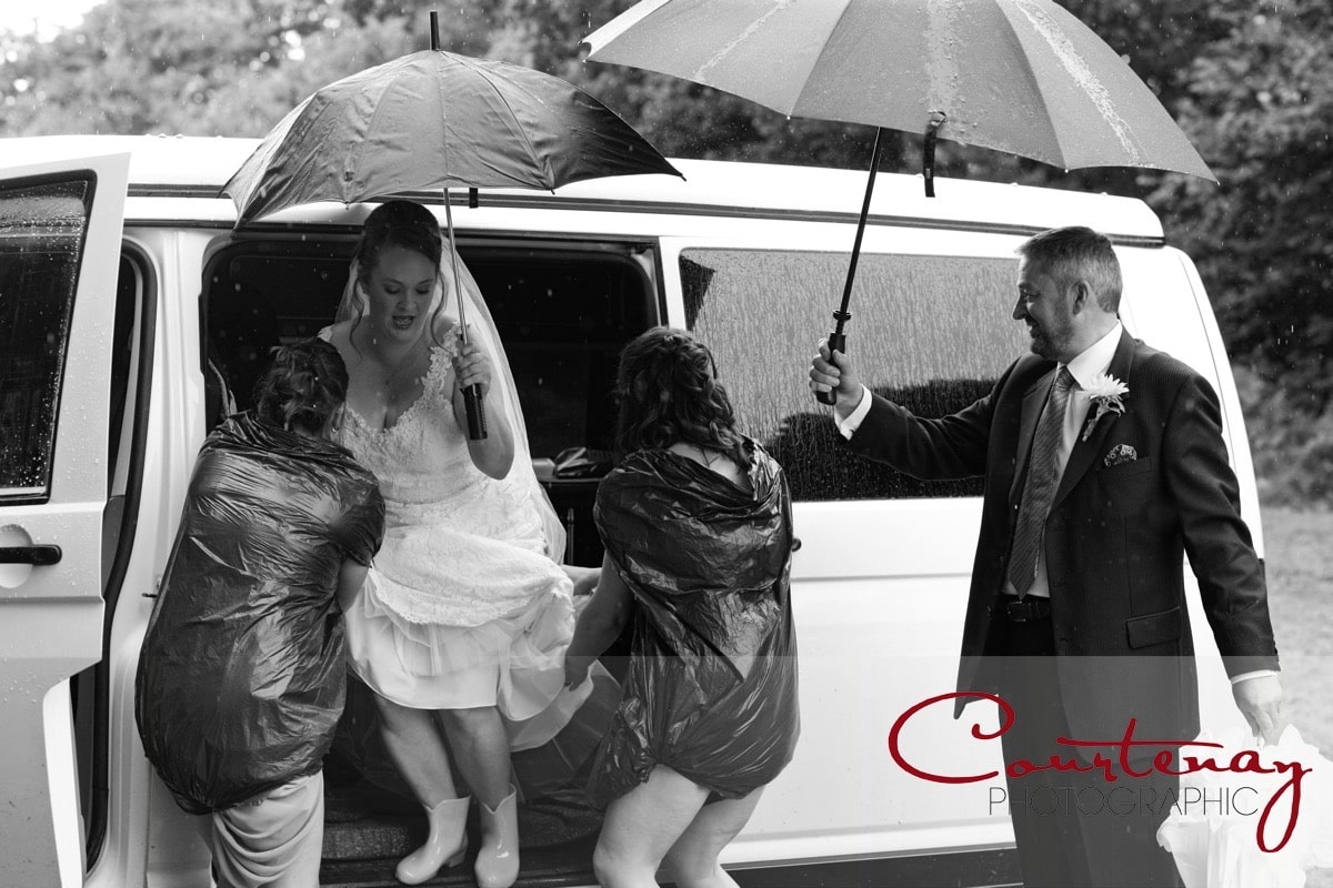 bride helped carefully from the van