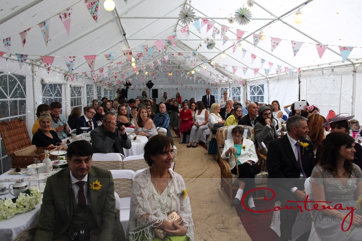 guests seated at table for ceremony