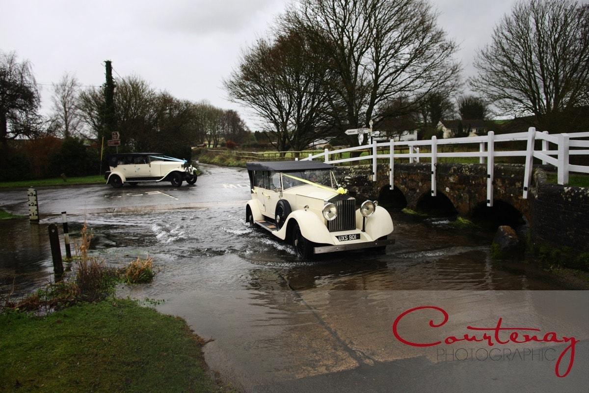 wedding cars head through the ford