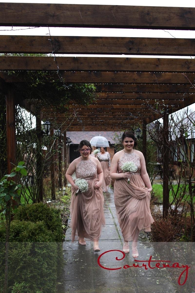 bridesmaids enter venue