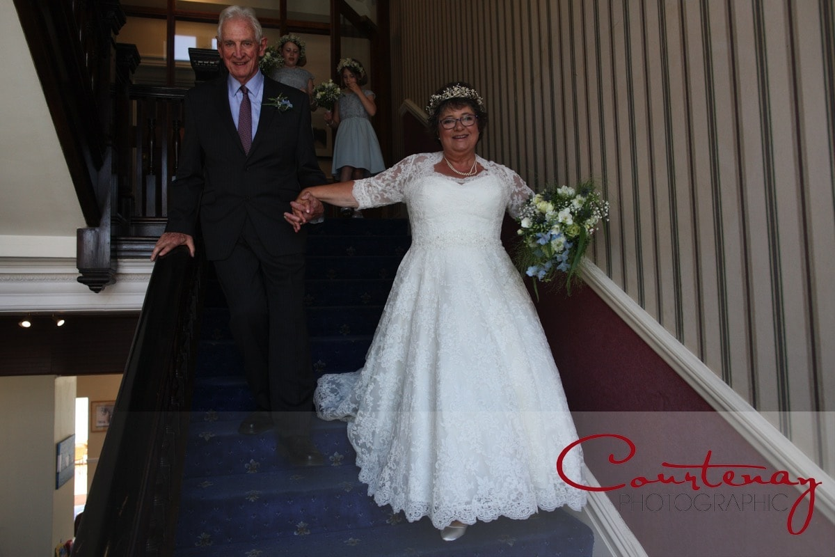 bride and dad come downstairs