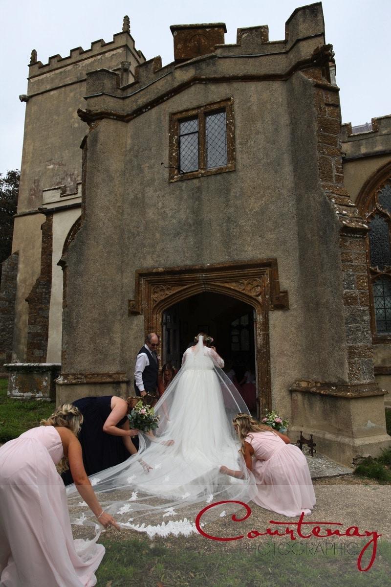 bride readies to enter church