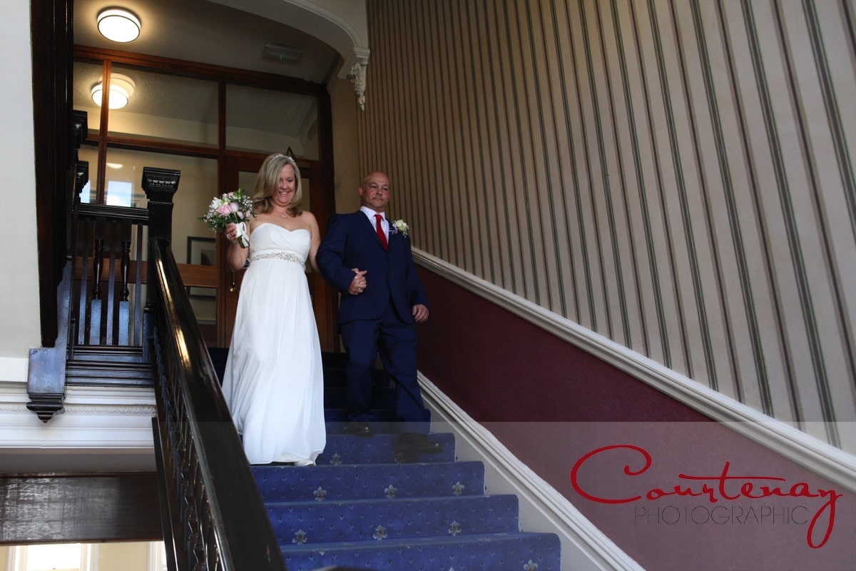 bride escorted downstairs