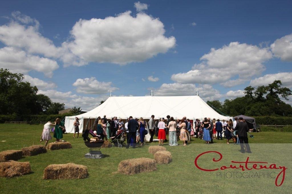 Hayhouse Farm wedding marquee and haybales